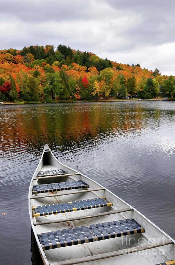 Canoe Photograph - Canoe On A Lake by Oleksiy Maksymenko