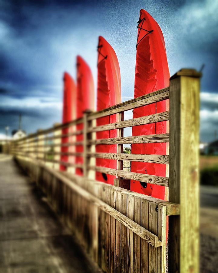 Canoes and walkway, Surf City, North Carolina by John Pagliuca