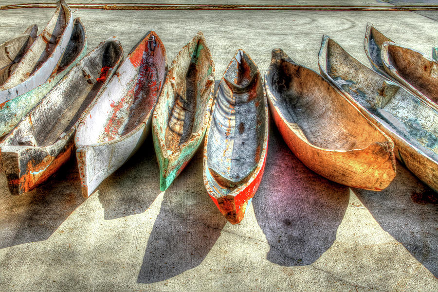 The Photograph - Canoes by Debra and Dave Vanderlaan