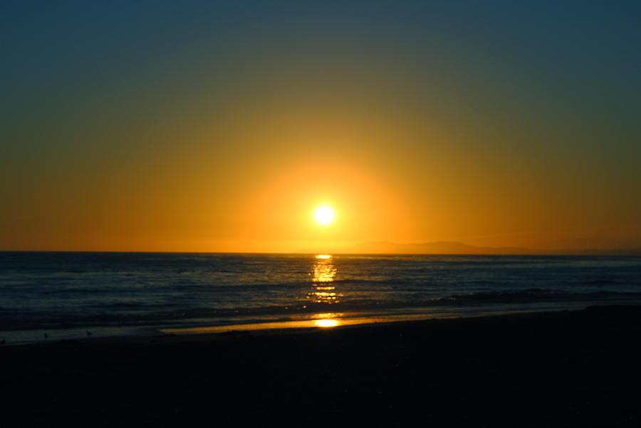 Sunset Photograph - Carpinteria State Beach At Sunset by Bransen Devey