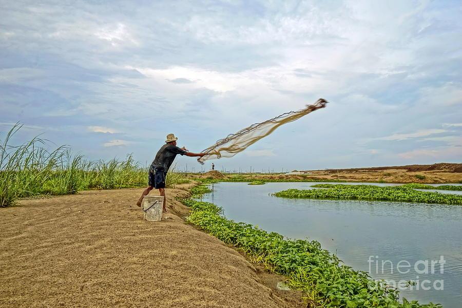 Landscape Photograph - Catch Fish by Arik S Mintorogo