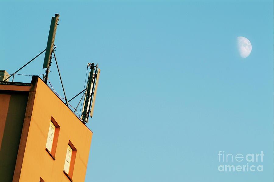 Antenna Photograph - Cellular Phone Antennas And A Half Moon At Sunset by Sami Sarkis