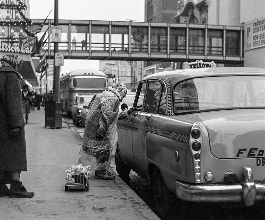 Chatting up a cabby on 7th Street by Mike Evangelist