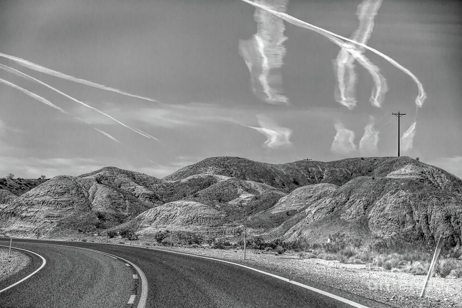 Valley Of Fire Photograph - Chem Trails Over Valley Of Fire Black White  by Chuck Kuhn