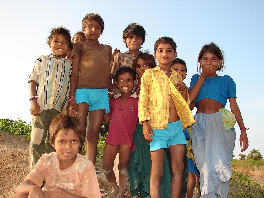 Childrens...enjoying Photograph by Sandeep Khanwalkar