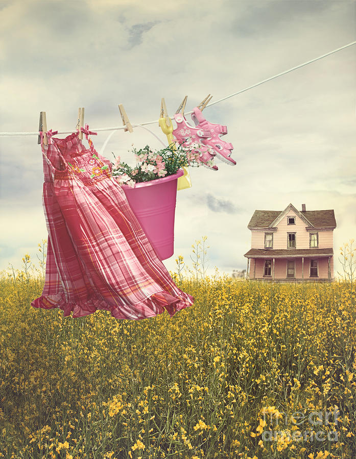 Childs Dress And Toys Hanging On Line With Farmhouse In Backgro Photograph by Sandra Cunningham