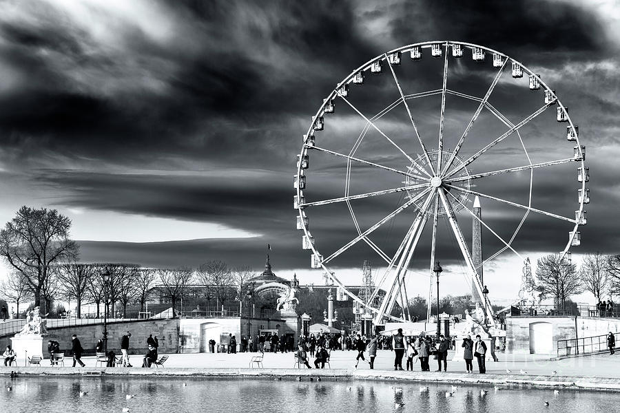 clouds photograph christmas ferris wheel in paris by john rizzuto