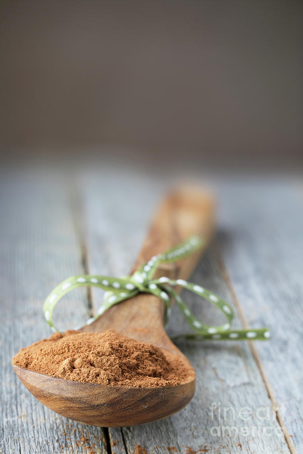 Cinnamon Powder In Wooden Spoon. Photograph