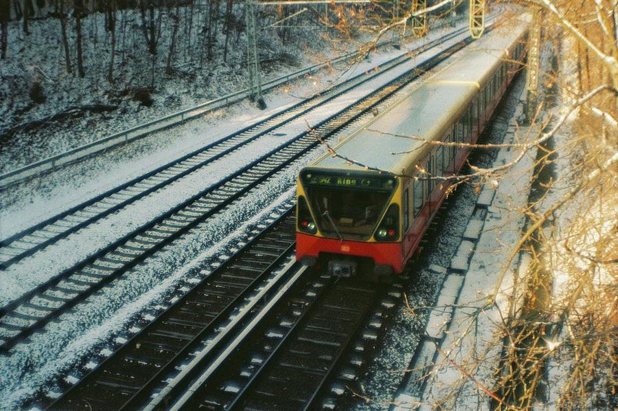 Berlin Photograph - City train in Berlin under the snow by Nacho Vega