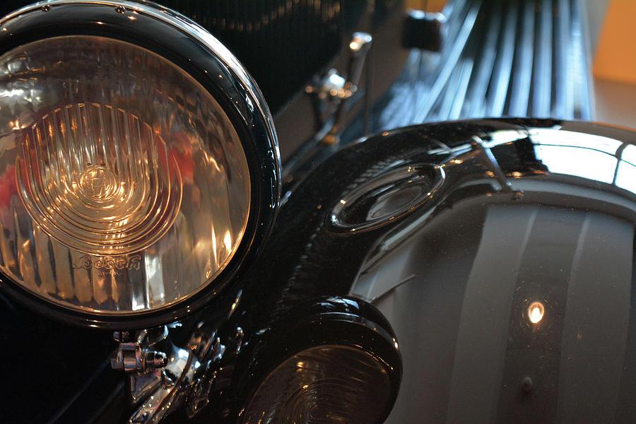 Car Photograph -  Close Up On Black Shining Car Round Light by Oana Unciuleanu