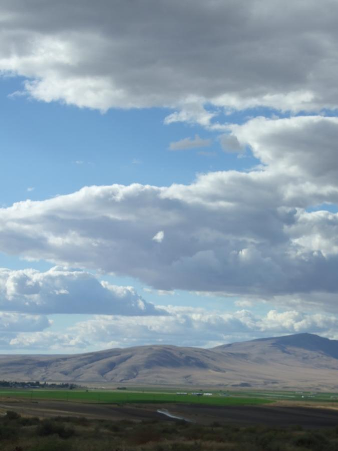 Clouds Photograph - Cloudbreaks Over Rattlesnake by Ruth Stromswold