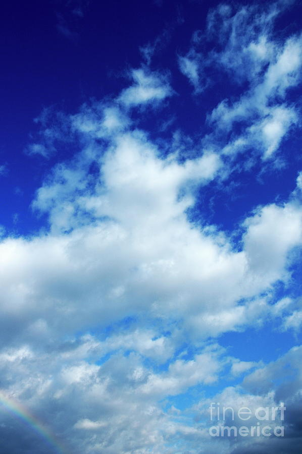 Blue Sky Photograph - Clouds In A Beautiful Blue Sky by Sami Sarkis