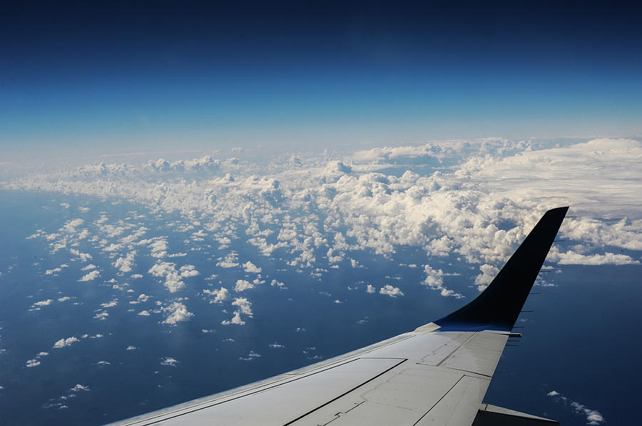 Fly Photograph - Clouds Under An Airplane Wing by Maksym Kaharlytskyi