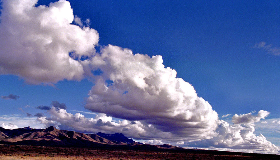 Clouds Marching by Randy Oberg