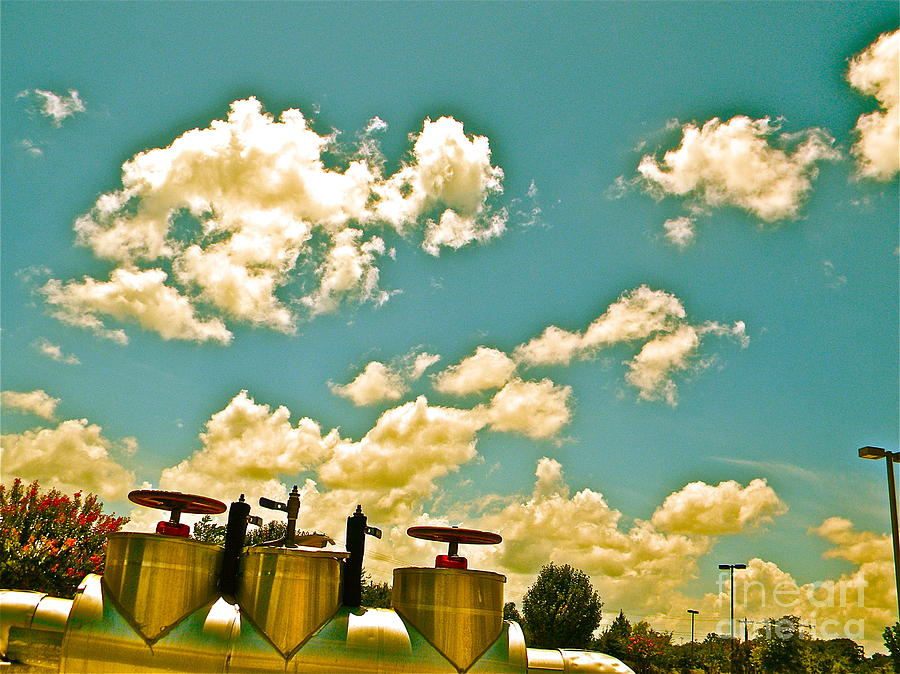 Clouds Photograph - Clouds Over Oil Field Equipent by Chuck Taylor