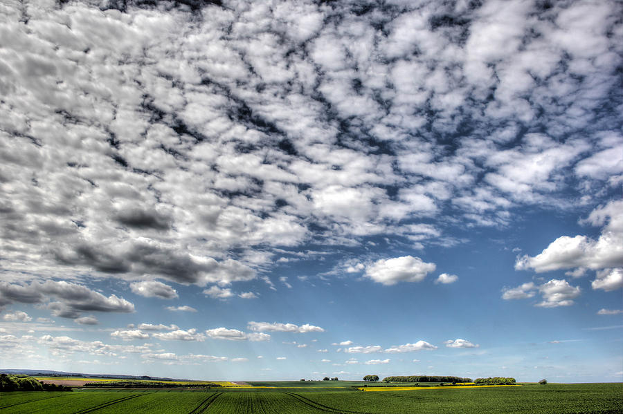 Clouds Photograph - Clouds over rural Hampshire by Peggy Berger