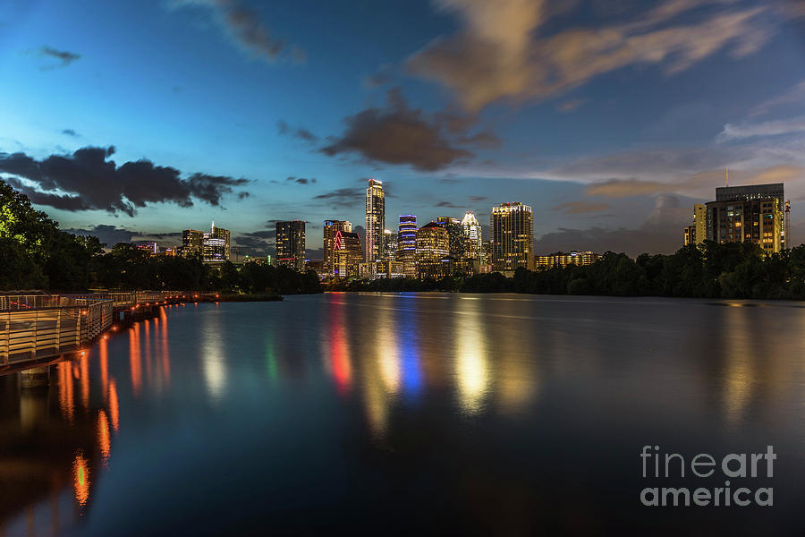 Clouds Photograph - Clouds Roll Over The Austin Skyline As The Neon Reflects In The Glass-like Waters Of Lady Bird Lake by Austin Welcome Center