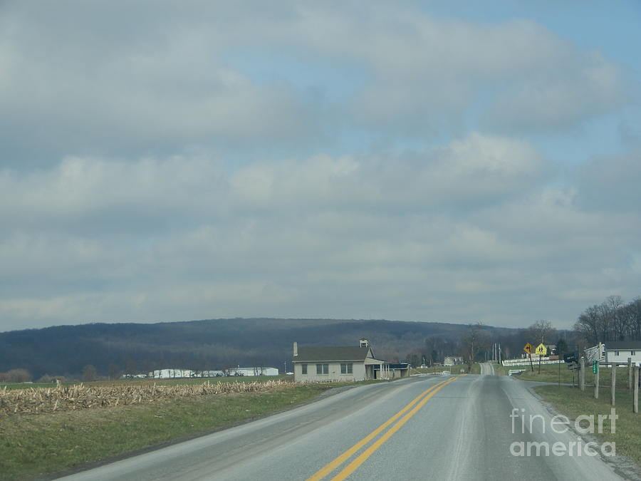 Amish Photograph - Cloudy Skies Over The Schoolhouse Ahead by Christine Clark