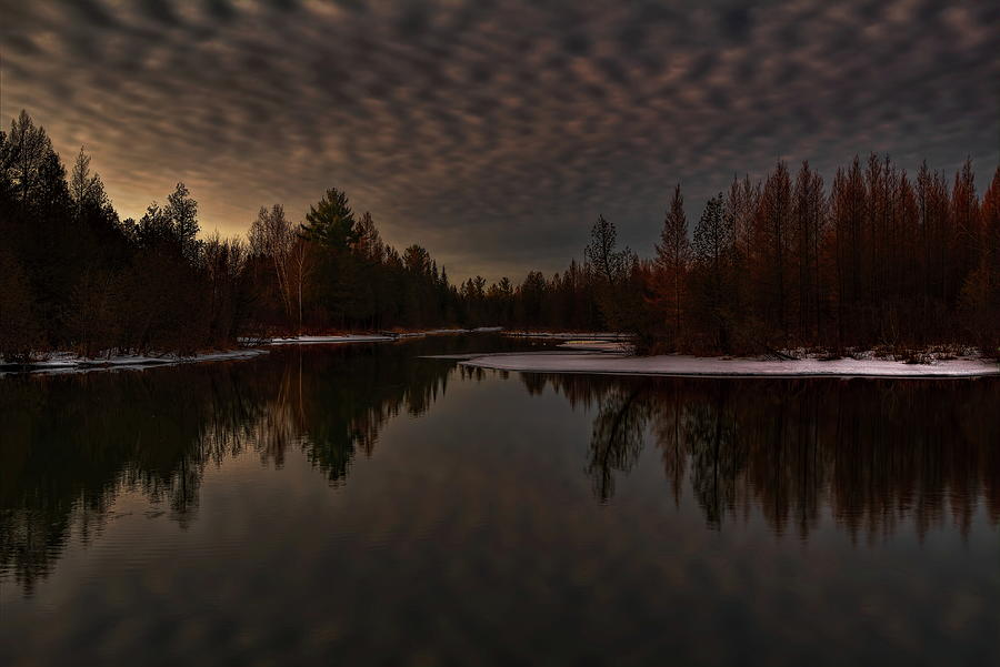 Cloudy Sunrise Over A Spring Fed Pond by Dale Kauzlaric