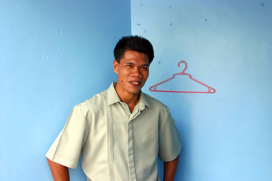 Philippines Photograph - Coat Hanger Smile 2 by Jez C Self