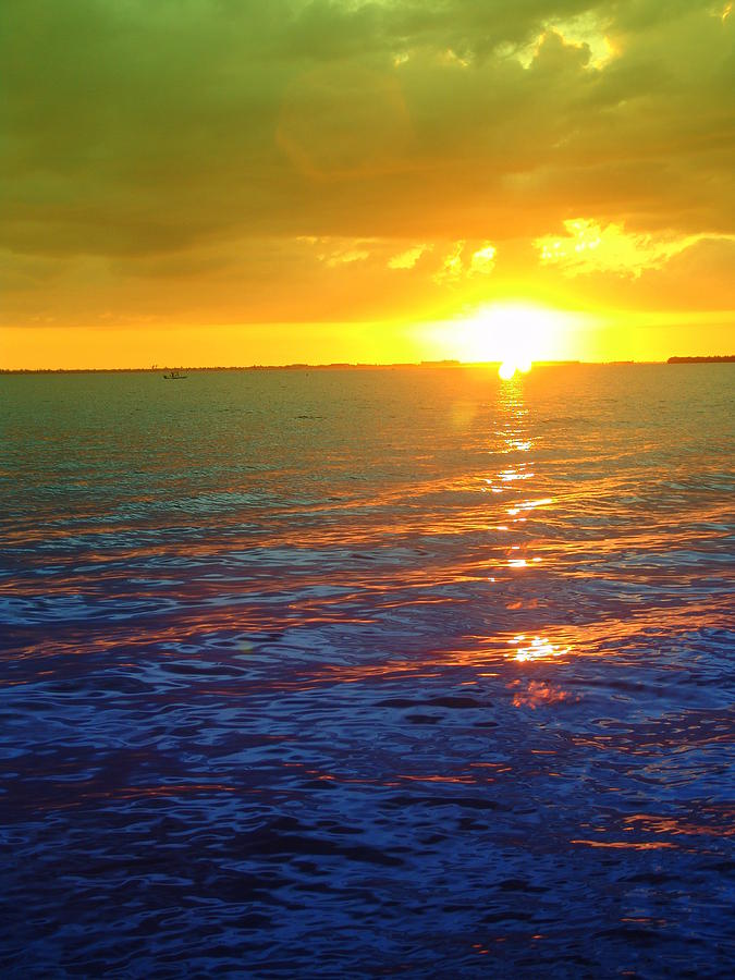 Sunset Photograph - Color Me A Tropic Sunset by Florene Welebny