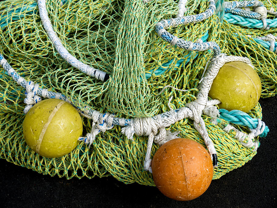 Color Photograph - Colorful Fishing Nets and Buoys by Carol Leigh