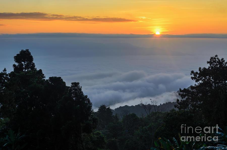 Sun Photograph - Colorful Sunrise Above The Clouds by Yongkiet Jitwattanatam