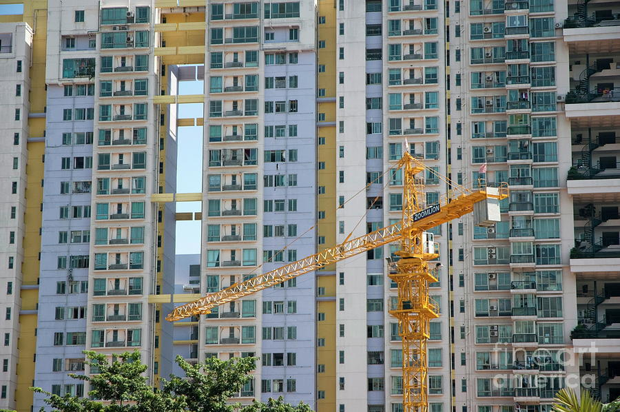Apartment Building Front construction crane in front of the facade of a large apartment
