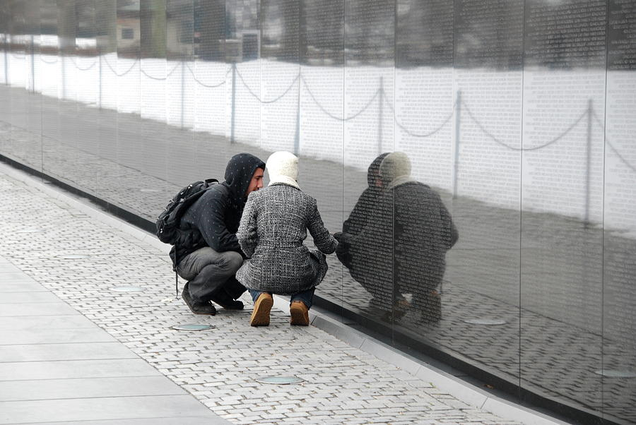 Couple at Vietnam Wall by Francis Chester