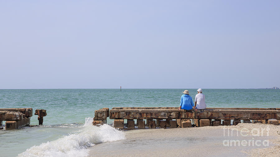 Jetty Photograph - Couple Sitting On An Old Jetty Siesta Key Beach Florida by Edward Fielding