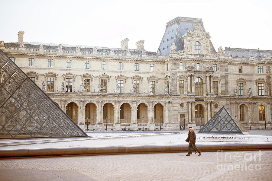 Couple strolling at Louvre museum  by Ivy Ho