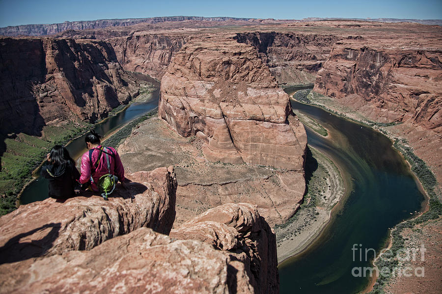 Horseshoe Bend Photograph - Couple Viewing Horseshoe Bend High Up Edge  by Chuck Kuhn