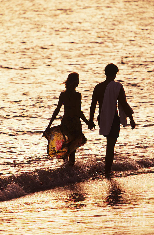 Ashore Photograph - Couple Wading In Ocean by Larry Dale Gordon - Printscapes