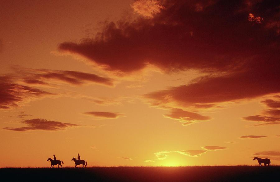 Cowboys At Sunset In Montana X Photograph