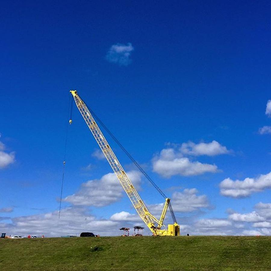Industrial Photograph - Crane On Road Construction Site by Juan Silva