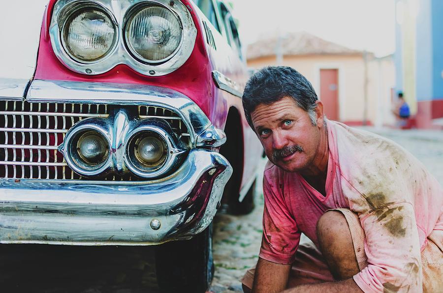 Auto Photograph - Cuban Mechanic by Blaz Gvajc