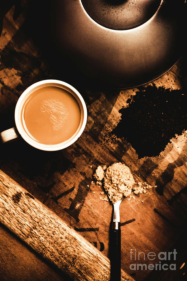 Cup Of Tea With Ingredients And Kettle On Wooden Table Photograph