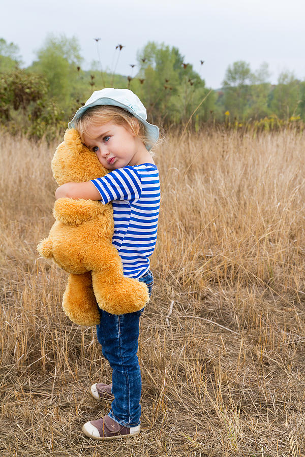 5dacd4ca97ea Cute Little Girl Hugging A Big Teddy Bear Photograph by Vyaheslav ...