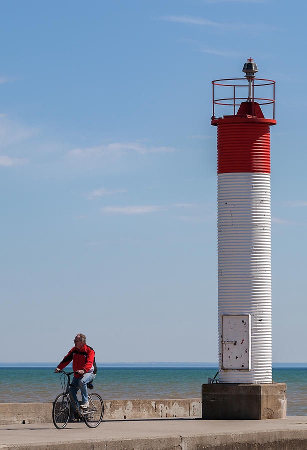 Cyclist by the Lighthouse by Al Poullis