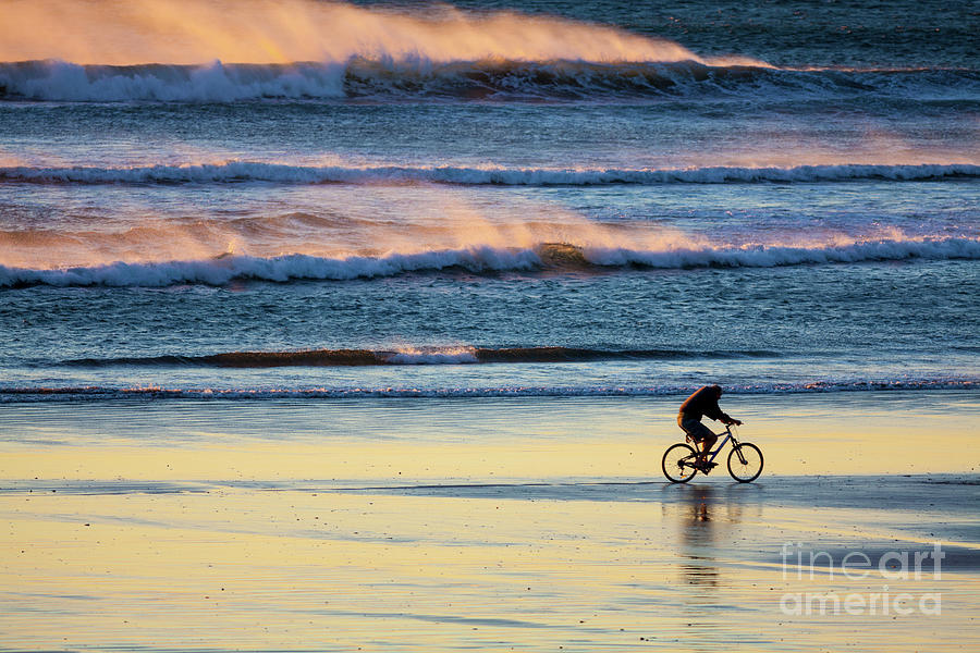 Cyclist Photograph - Cyclist Pedals Against the Wind at Pismo Beach by Sharon Foelz