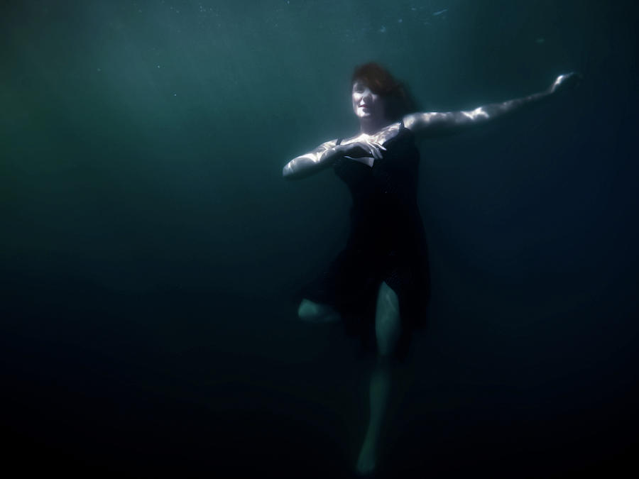 Underwater Photograph - Dancing Under The Water by Nicklas Gustafsson