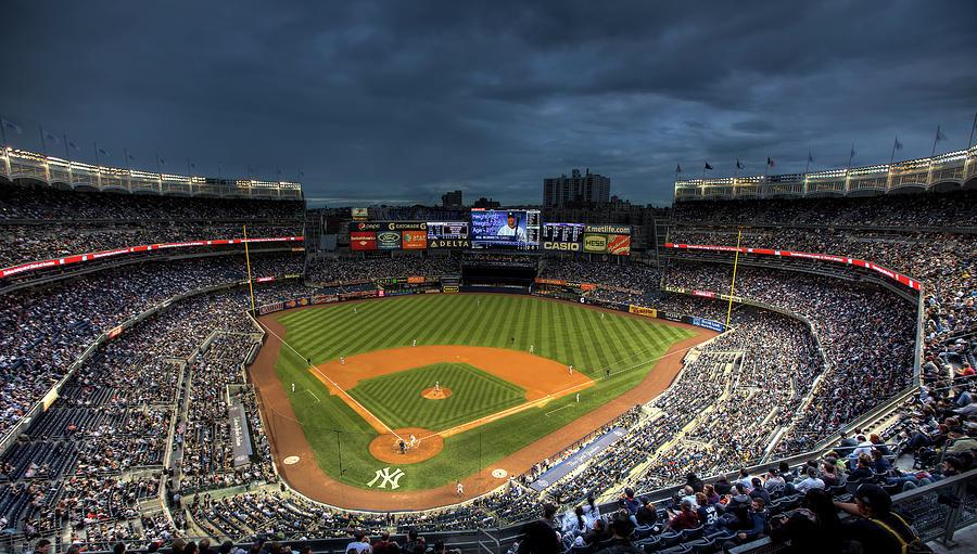 Yankee Stadium Photograph - Dark Clouds Over Yankee Stadium  by Shawn Everhart
