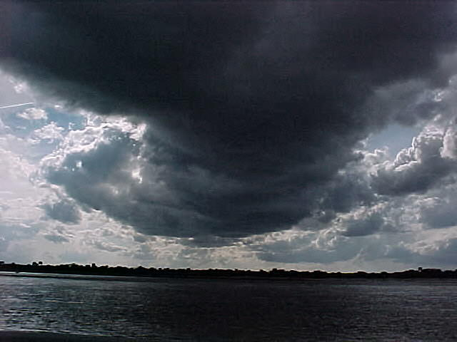 Clouds Photograph - Dark Moves Across The Land. by Ricky  Rayburn