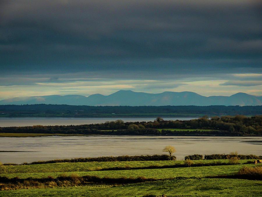 Autumn Photograph - Dark Skies Over Irelands Shannon Estuary by James Truett
