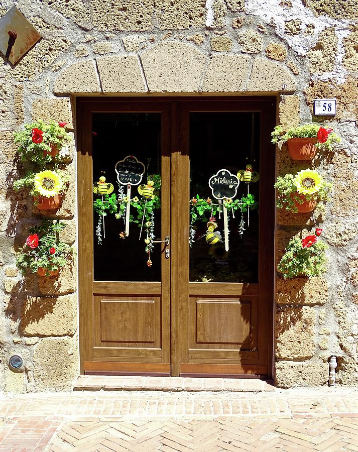 Flowers Decorating Storefront In Tuscany Photograph by ...