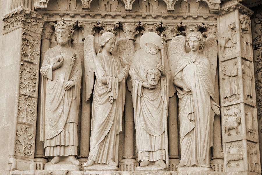 Detail Of The Sculpture Art To The Left Of The Entrance To Notre Dame Cathedral Paris France Sepia