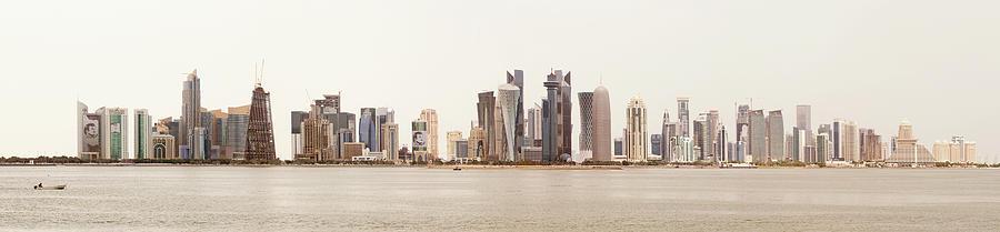 Doha skyline against a white sky by Paul Cowan