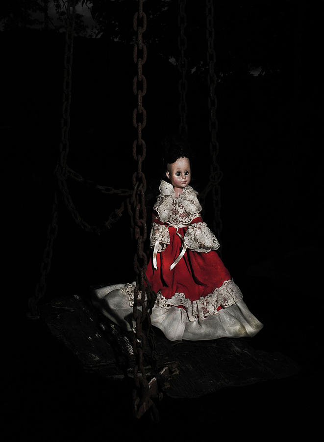 doll on a swing by Rose Benson