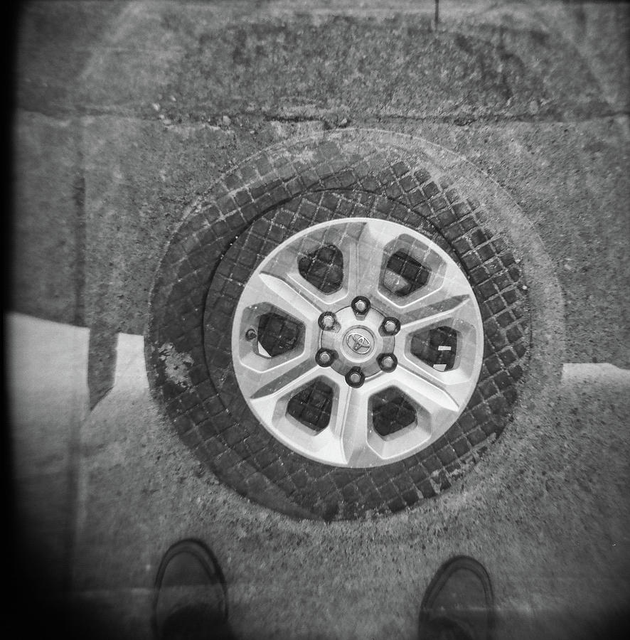 Holga Photograph - Double Exposure Manhole Cover Tire Holga Photography by Lisa Shea
