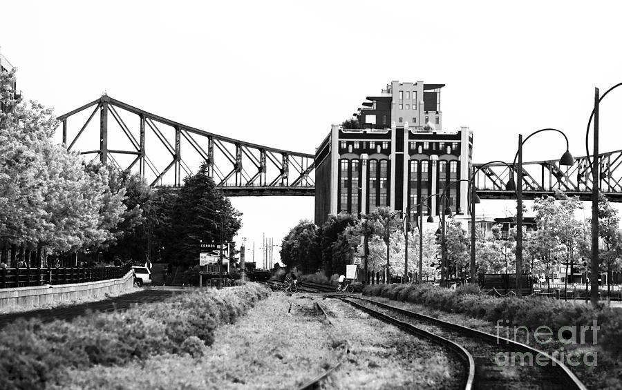 Montreal Photograph - Down The Tracks by John Rizzuto